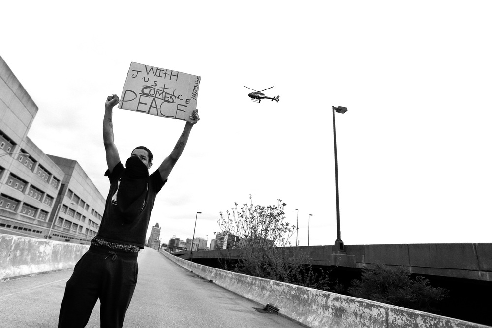 A protestor stands on an exit ramp for I-83 North near the Baltimore City Detention Center on  401 E. Eager Street after the announcement that all six officers will be charged following the death of Freddie Gray while he was in police custody,  May 1, 2015 in Baltimore, Maryland.