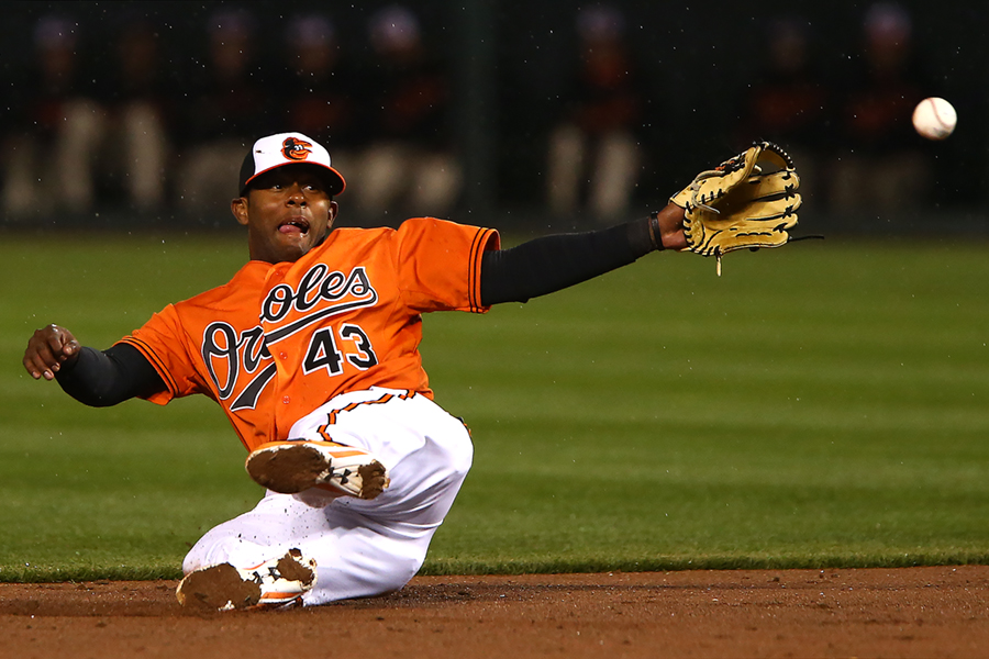 Baltimore Orioles second baseman Rey Navarro attempts to make the throw to second base during a MLB game against the Boston Red Sox at Oriole Park at Camden Yards in Baltimore, Maryland on April 25, 2015.