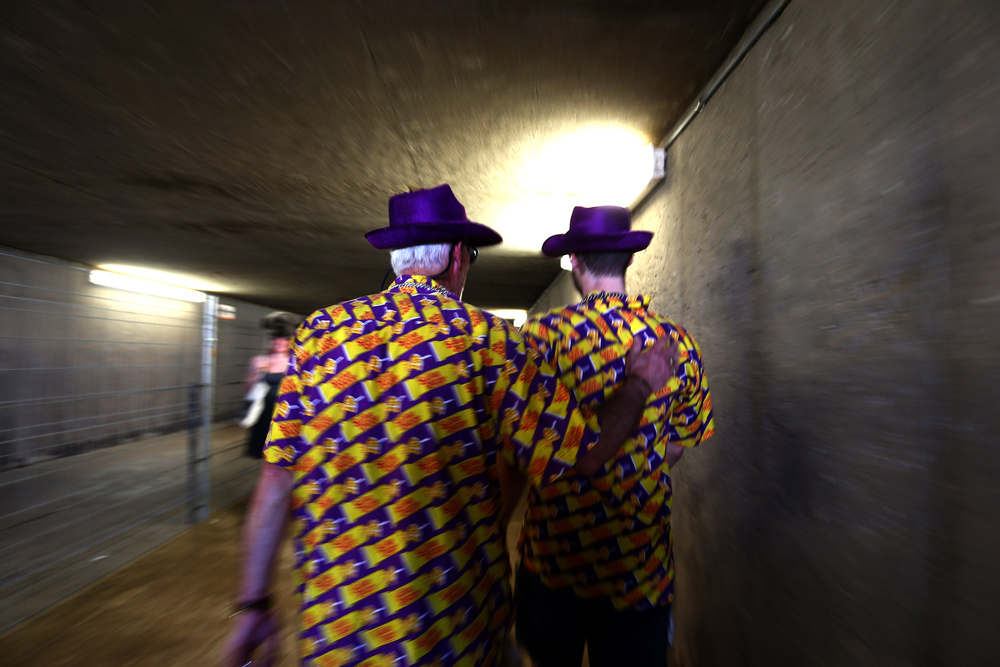 Fans walks through the tunnel from the infield before the start of the 140th Preakness Stakes at Pimlico Race Course on May 16, 2015 in Baltimore, Maryland.