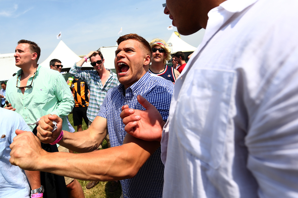 A fan cheers during a race before the start of the 140th Preakness Stakes at Pimlico Race Course on May 16, 2015 in Baltimore, Maryland.