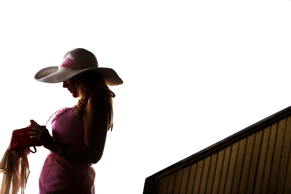 A fan walks out into the grandstand before the start of the 140th Preakness Stakes at Pimlico Race Course on May 16, 2015 in Baltimore, Maryland.