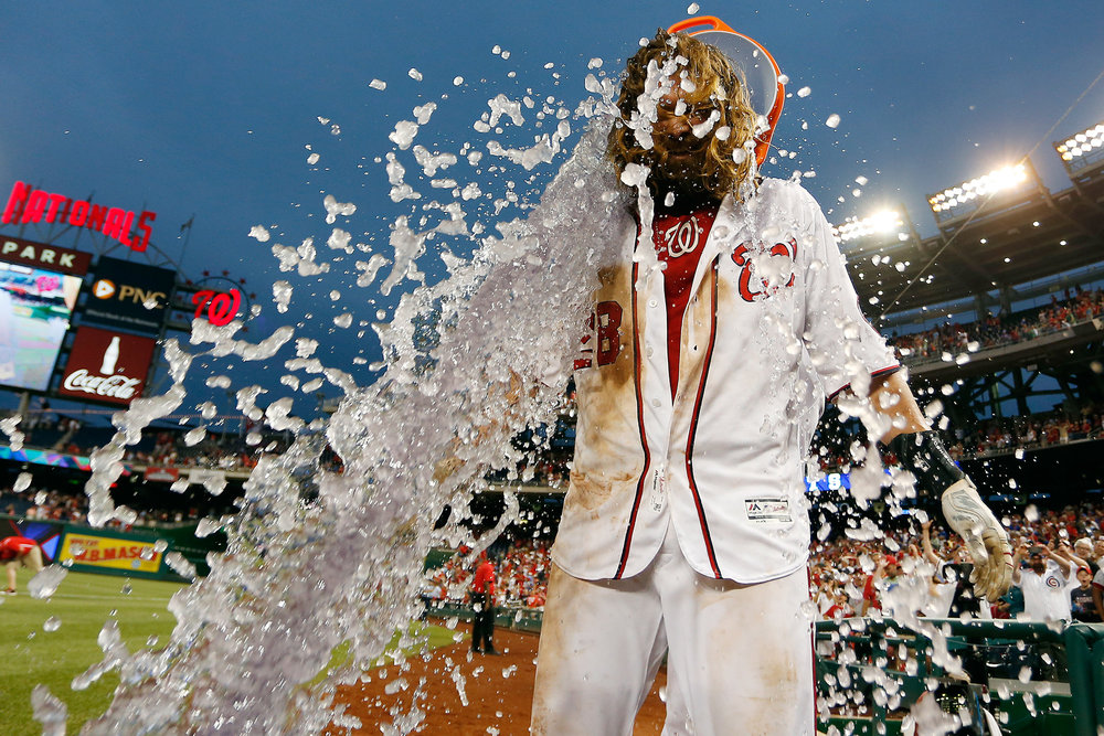 Jayson Werth #28 of the Washington Nationals is doused with a bucket of Gatorade by teammate Wilson Ramos #40 after hitting a walk-off single RBI in the twelfth inning against the Chicago Cubs at Nationals Park on June 15, 2016 in Washington, DC.
