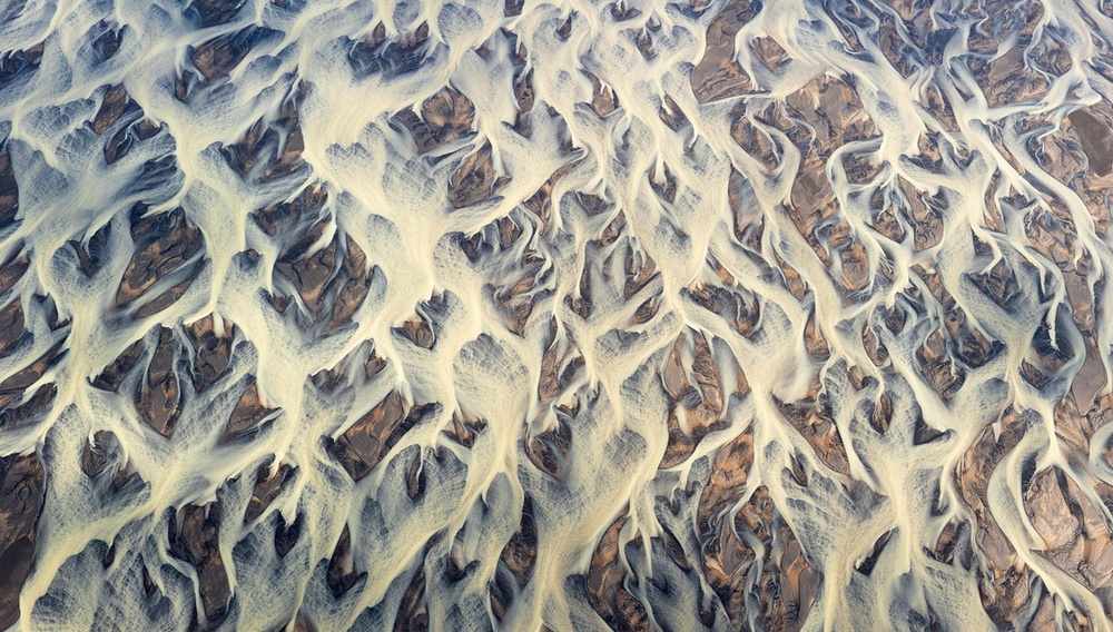 Aerial Photography Iceland. This image is aerial photo of glacial river in Iceland. The river divided into a great number of interlinked streams and flows.   The panorama. Seven vertical shots.