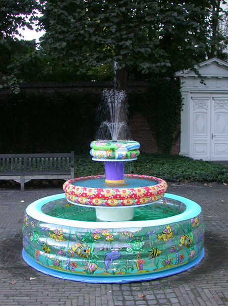 Title: Paddling Pool Fountain   Year: 2003   Materials: inflatable paddling pools, buckets, water pump, 3-head spray head, PVC, wood, tarp, glue, paint   Dimensions: L 234 cm W 234 cm H 280 cm