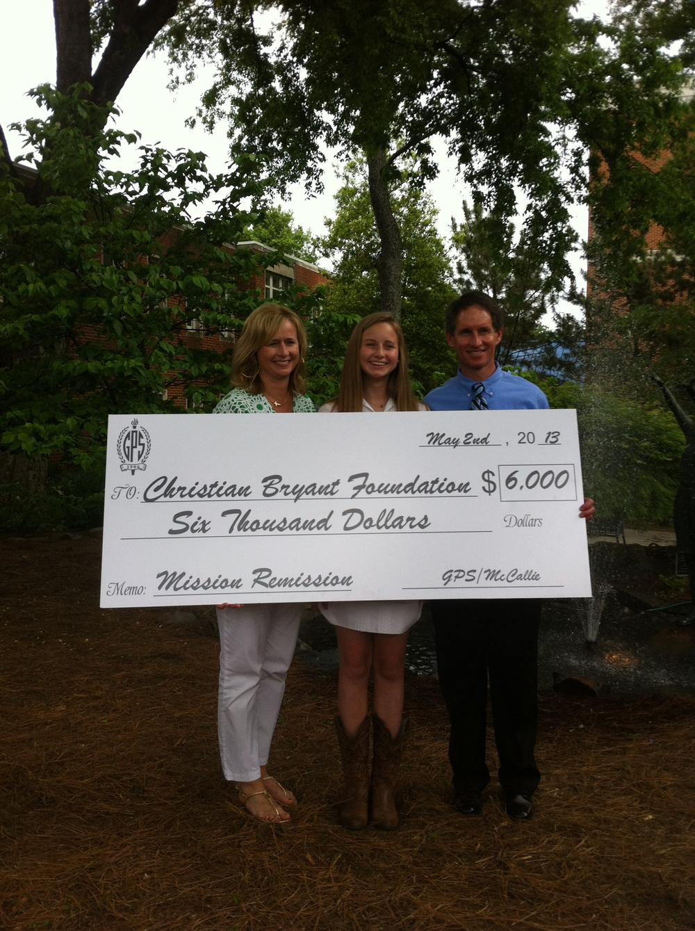 The Christian Bryant Foundation is presented with a $6,000 check from the GPS/McCallie Mission Remission