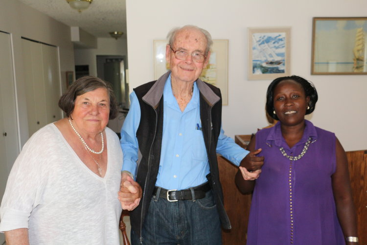 Dr. Edith visiting  with Alice King and Dr. Donald Gibson who served at Mengo Hospital as surgeon during the 50's. Don is our leader and inspiration who was responsible for the formation of our charity in 2002
