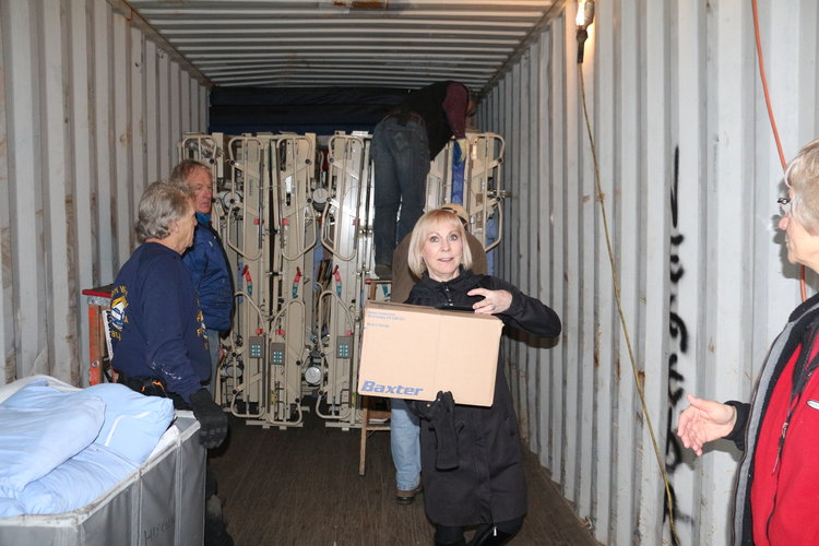Volunteers loading the 2016 container