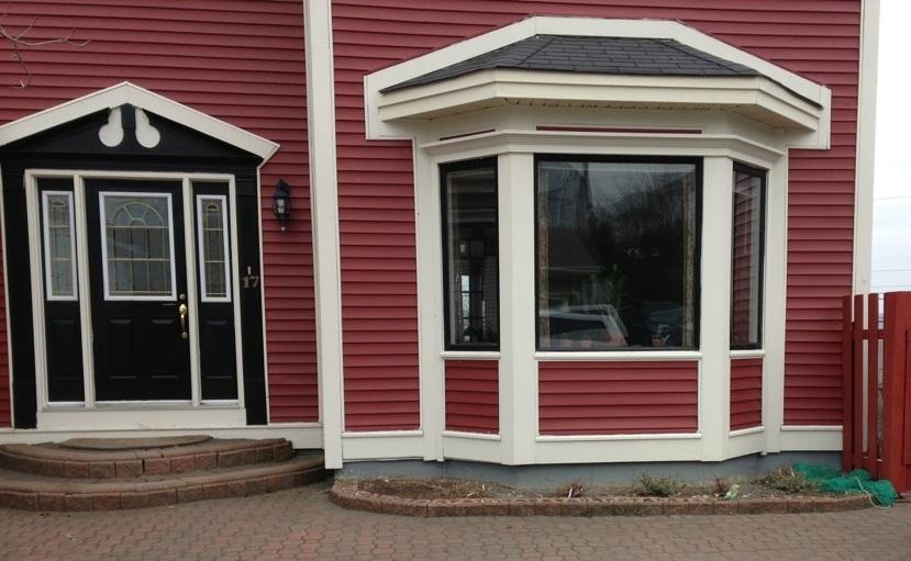 Before - black windows and door with improper stonework