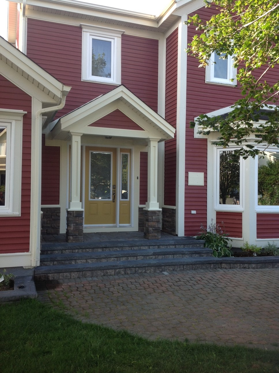 After - a beautiful covered porch with professional stonework
