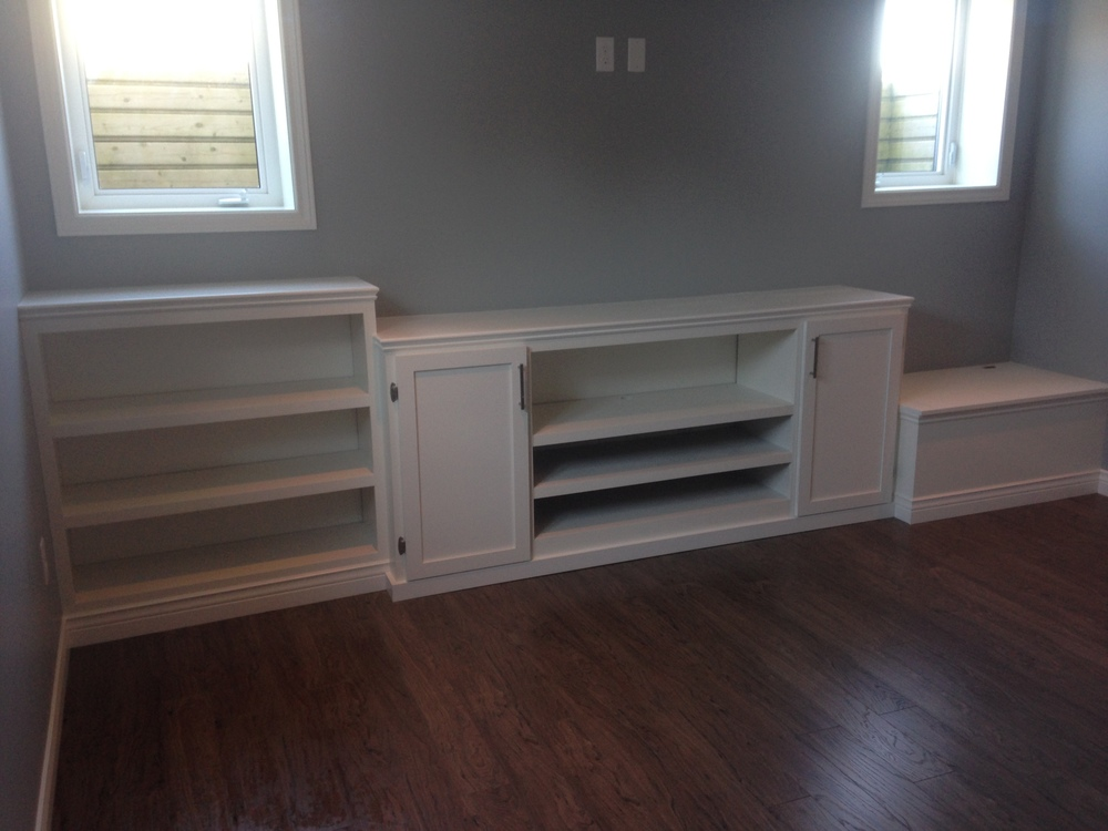 Custom media unit with shelves and bench storage