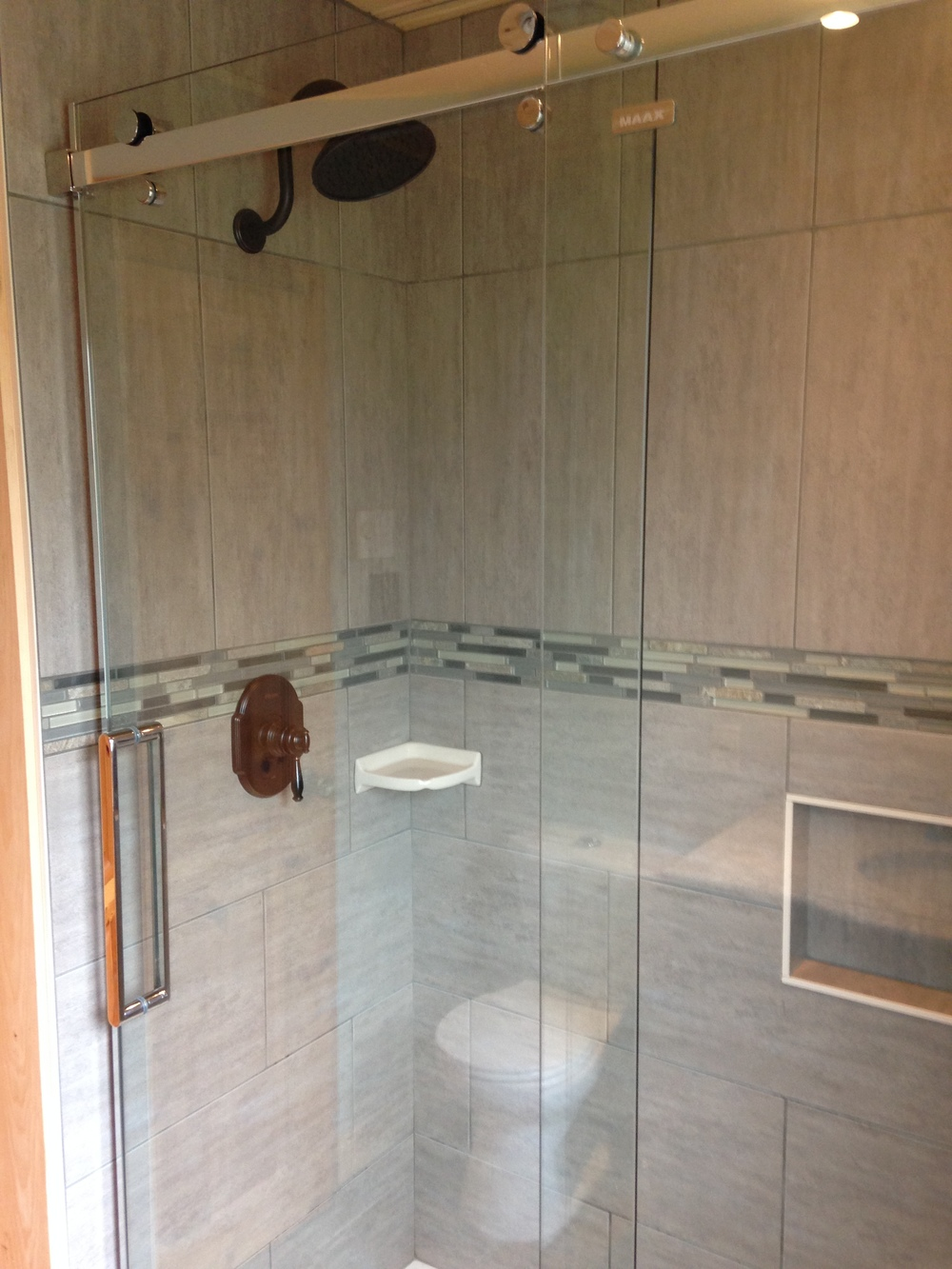 New tiled shower with glass doors and new hardware