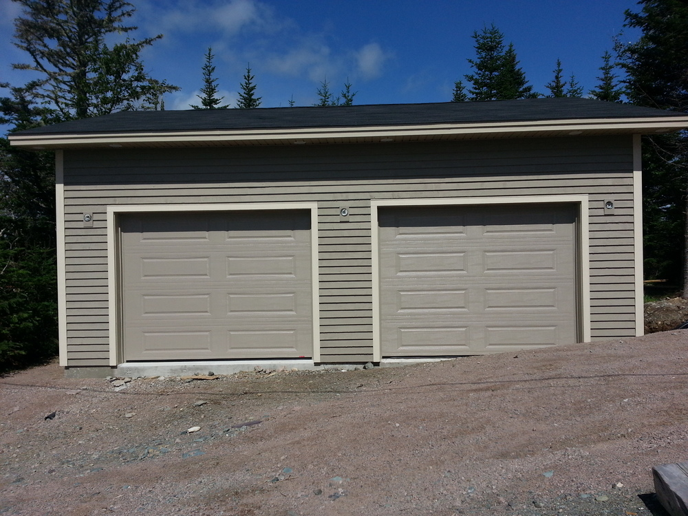 Factory finished garage doors.  Ready for light fixtures.