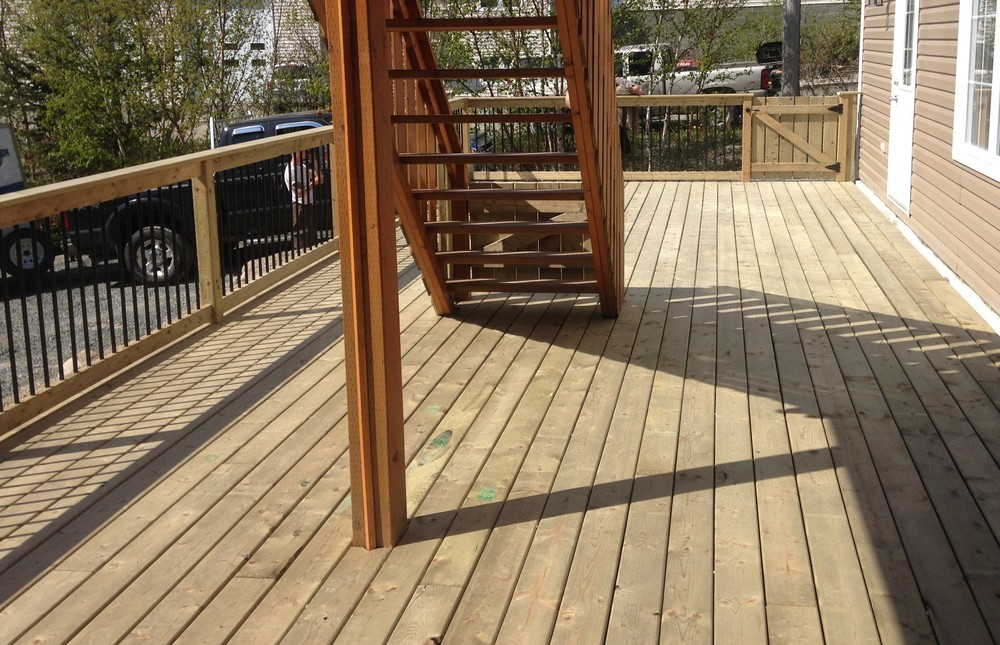 14' x 40' deck with wooden rails and rod iron spindles.