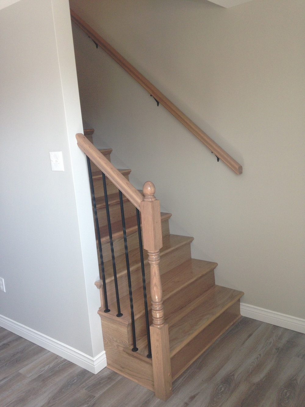 Newly constructed stairs leading to main floor of home