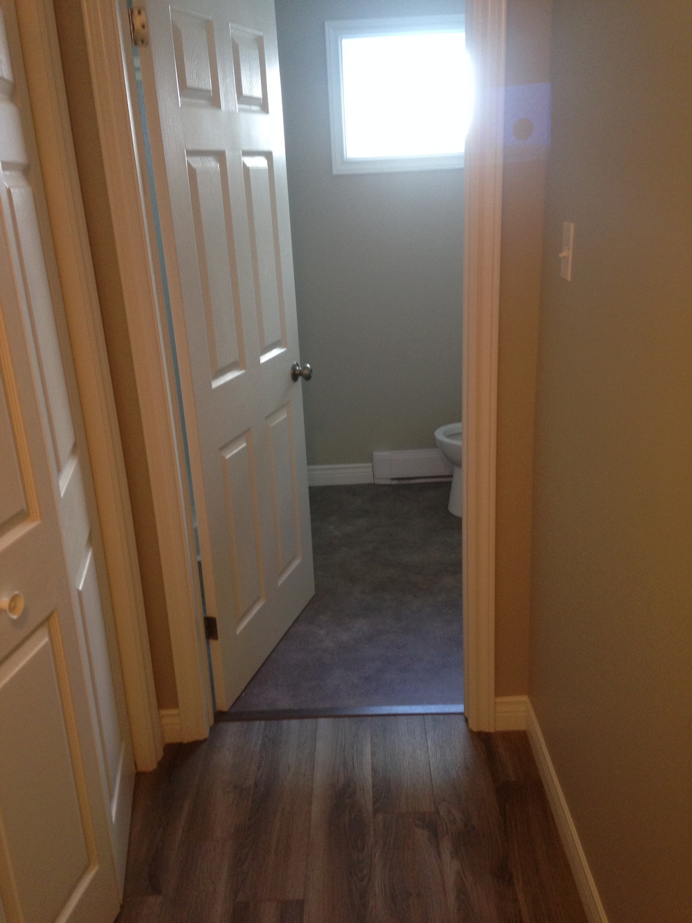 Hallway leading to 3-piece bathroom