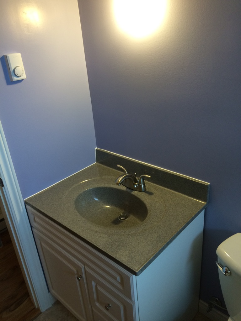 Vanity with solid top, new sink and faucet