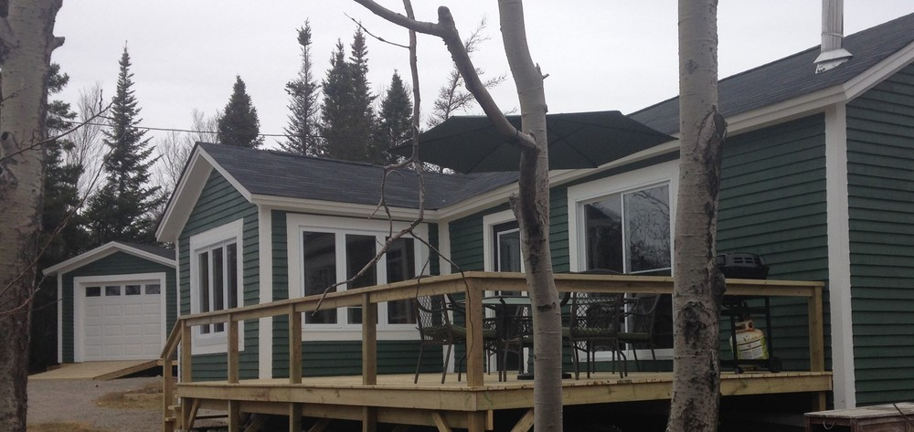 New wood siding and new deck to enjoy the view of the pond