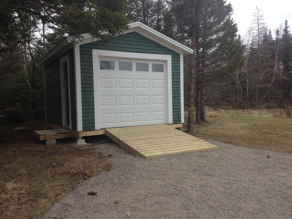 New shed with overhead door and ramp for toys and tools