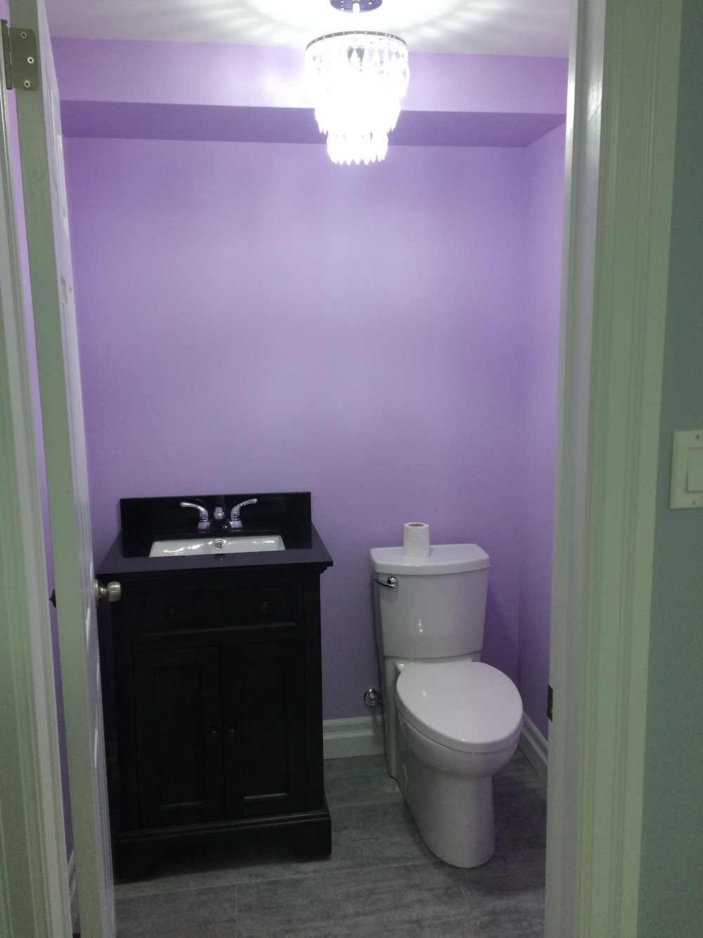 Bright half bath with jewel fixture
