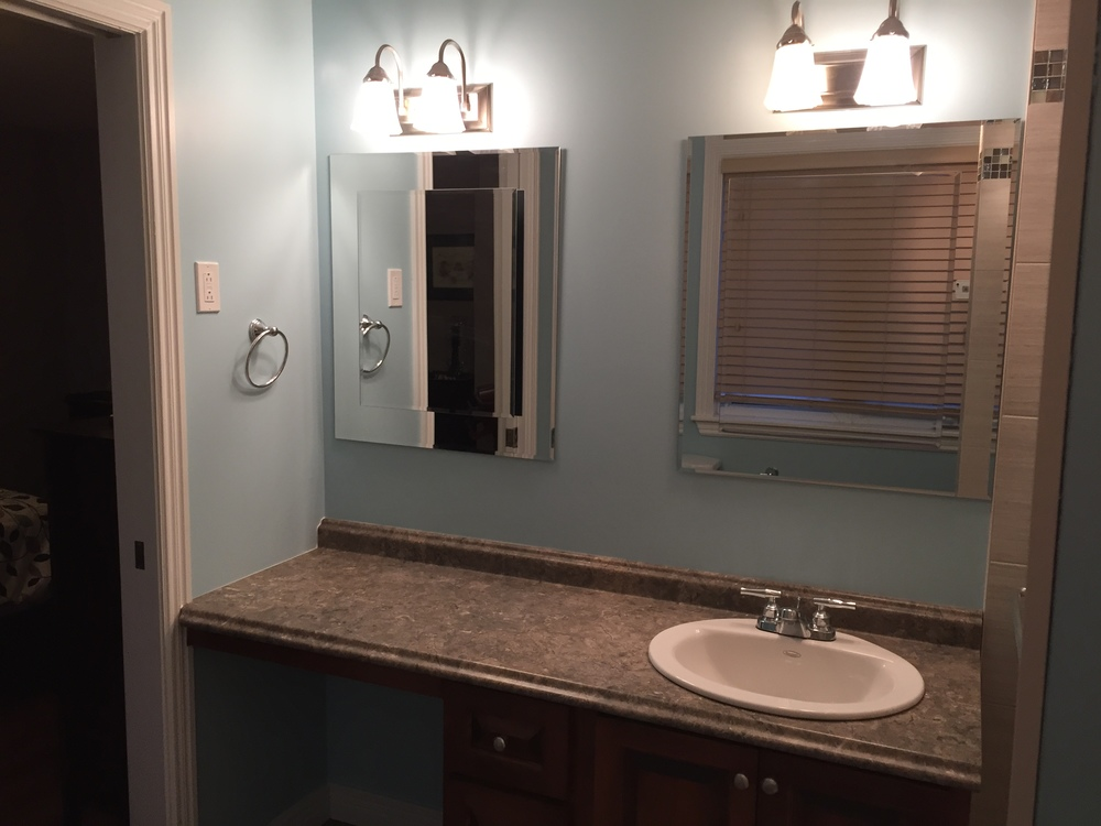 Updated lighting, mirrors and functional vanity with makeup area.