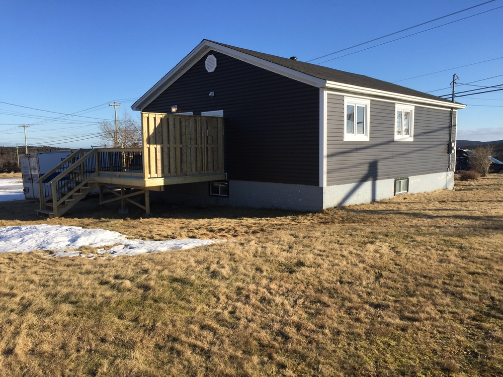 New siding, CapeCod trim and rear deck with privacy wall