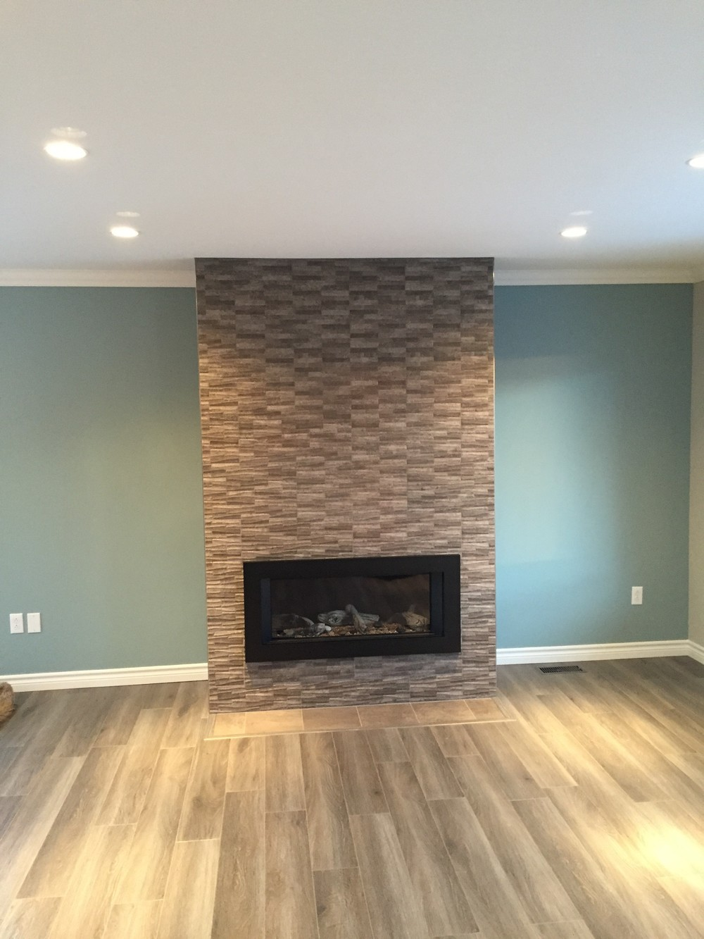 New custom propane tile fireplace is a beautiful focal point.