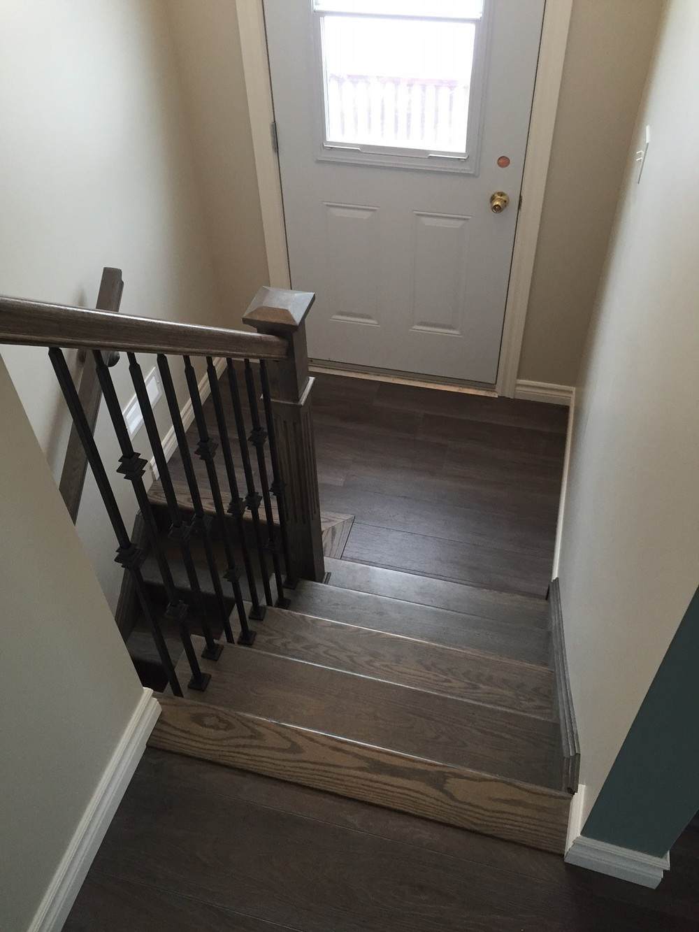 New hardwood stairs with custom rail.