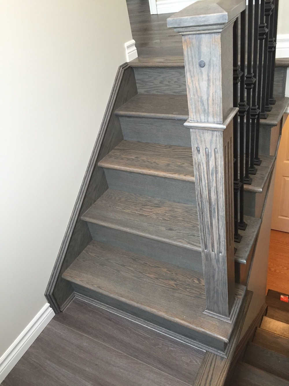 New custom hardwood stairs leading to landing.