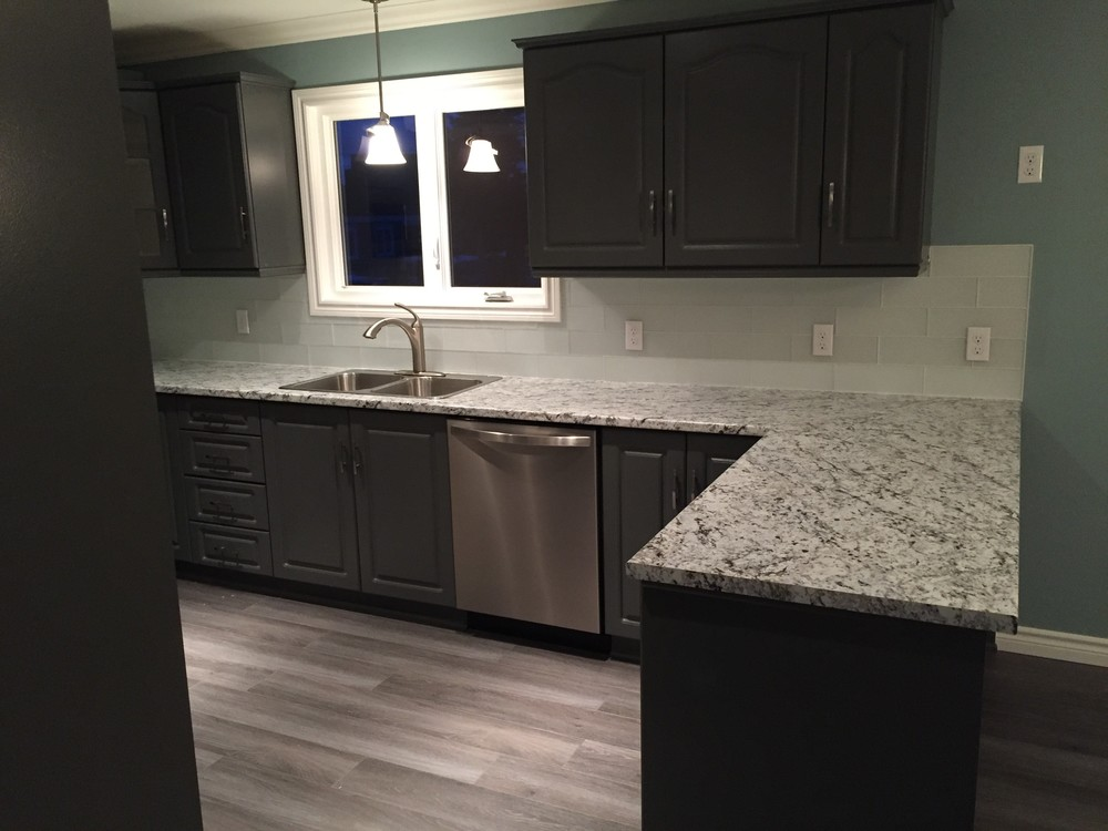 Beautiful new kitchen with refinished/redesigned cabinets and glass tile backsplash.
