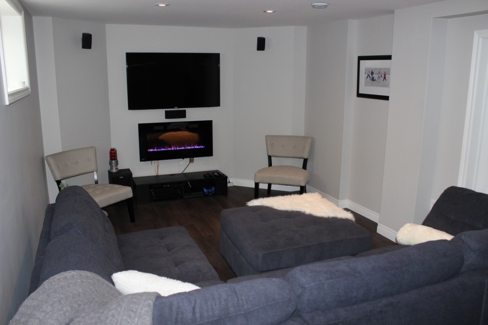 Furnished space with entertainment area, surround sound and electric fireplace.