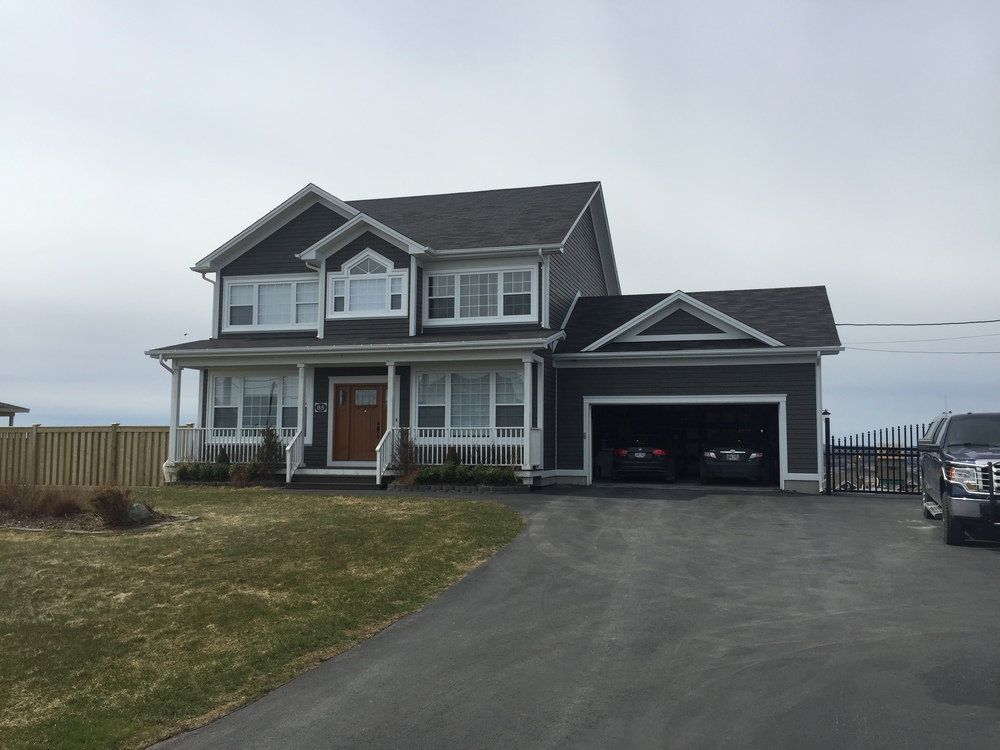 Complete exterior renovation with vinyl siding and trims replaced with Cape Cod.