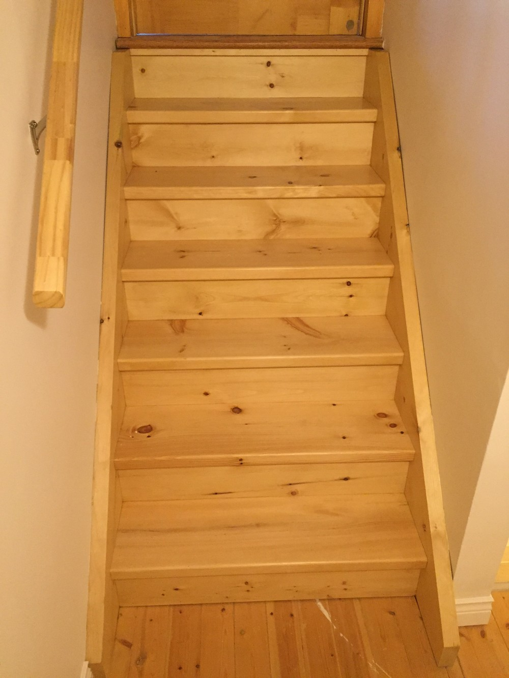 New custom pine stairs leading to main floor.