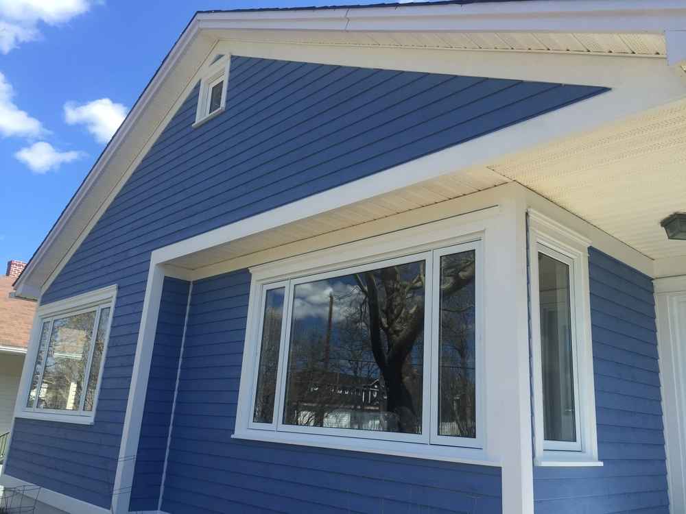 New siding, windows and finishes.