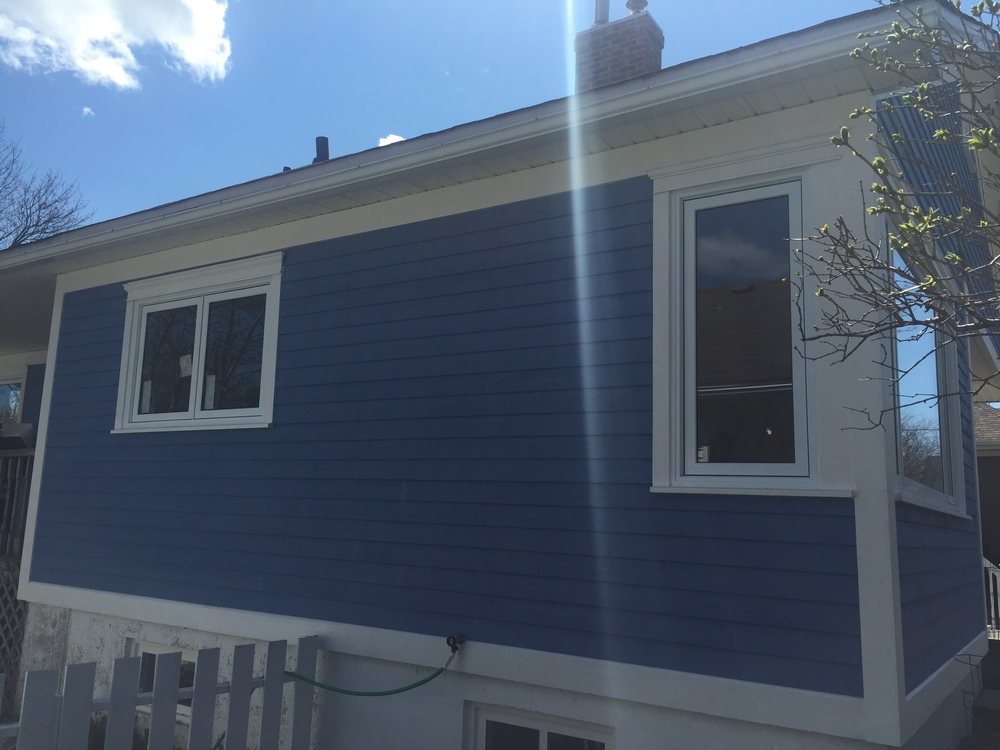 New siding, windows, roof and chimney.