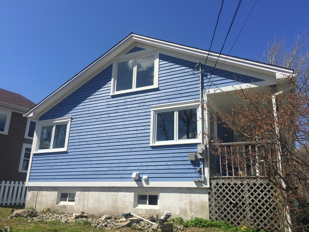 New Cape Cod siding, windows and finishes.