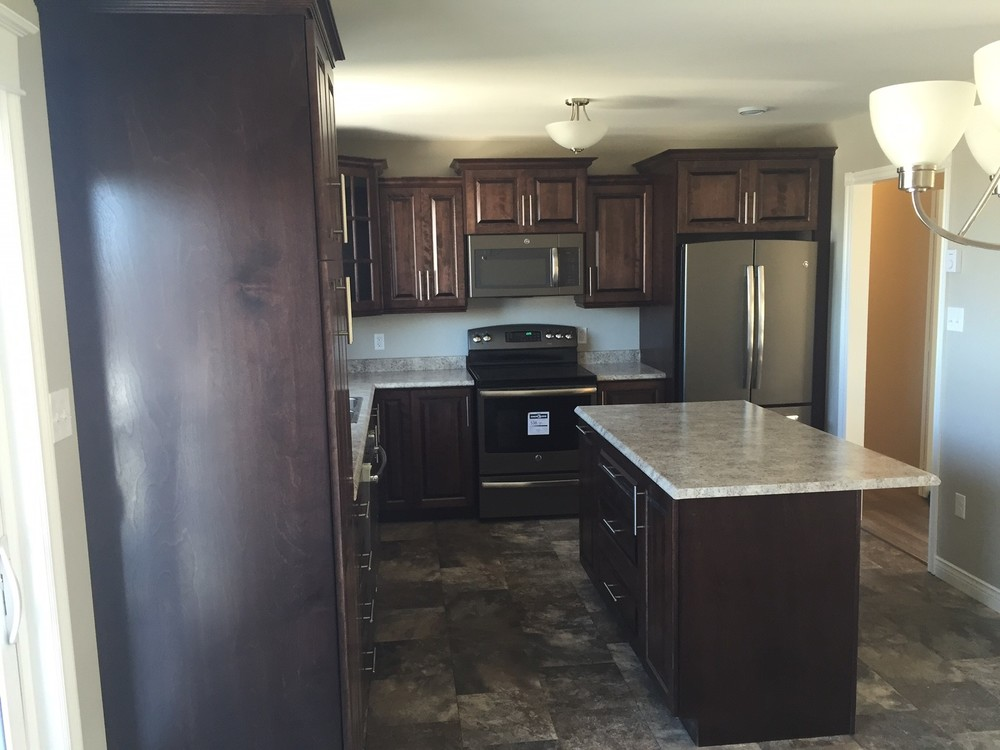 A completely renovated kitchen, with stainless appliances and all new finishes.
