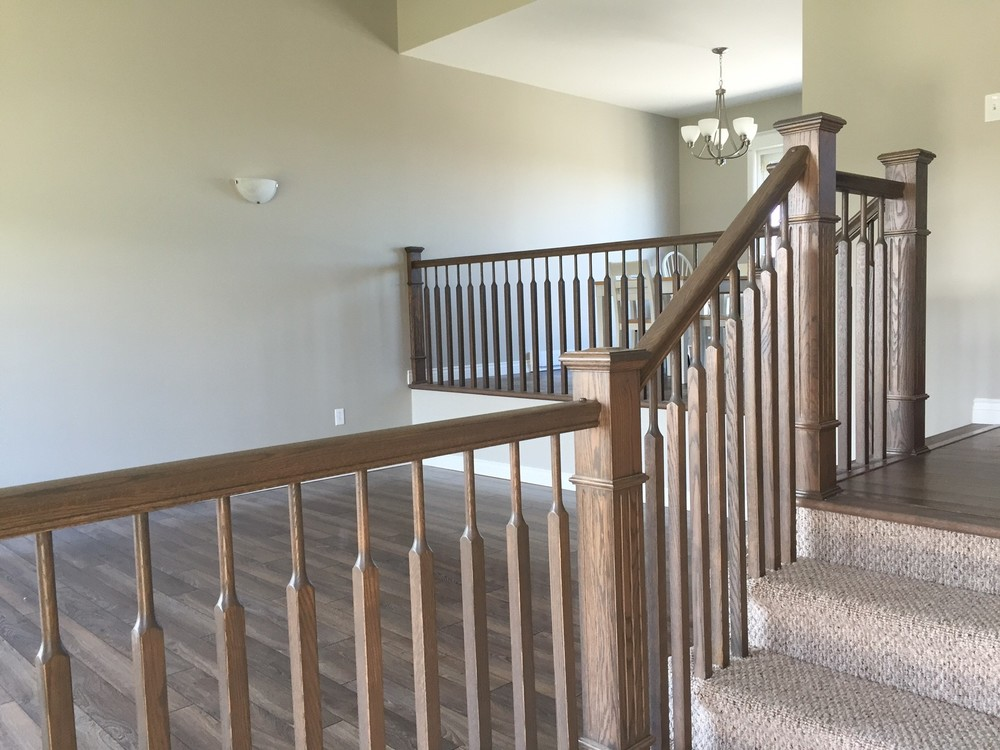 Wooden railing, stairs and new finishes make area feel larger and more inviting.