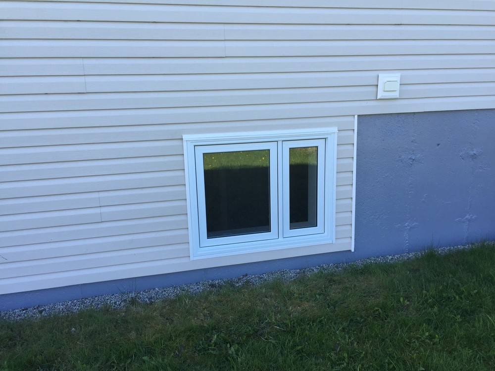 Bedroom window updated to meet egress specifications.