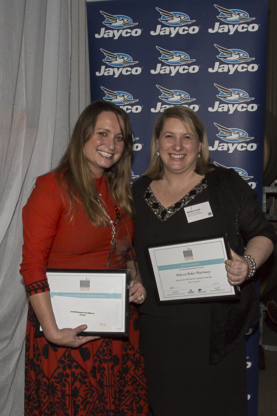Janelle toomey from bank street pizza and rebecca baker from rebecca baker pharmacy with their winner and runner up (respectively) awards for the small business excellence award - sponsored by bill sykes MP, Member for benalla.  PHOTO: RED NEST STUDIOS