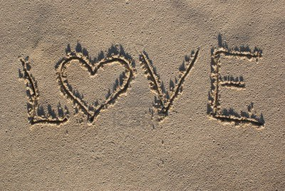 4294110-love-sign-written-on-sand-with-heart-shape-1.jpg