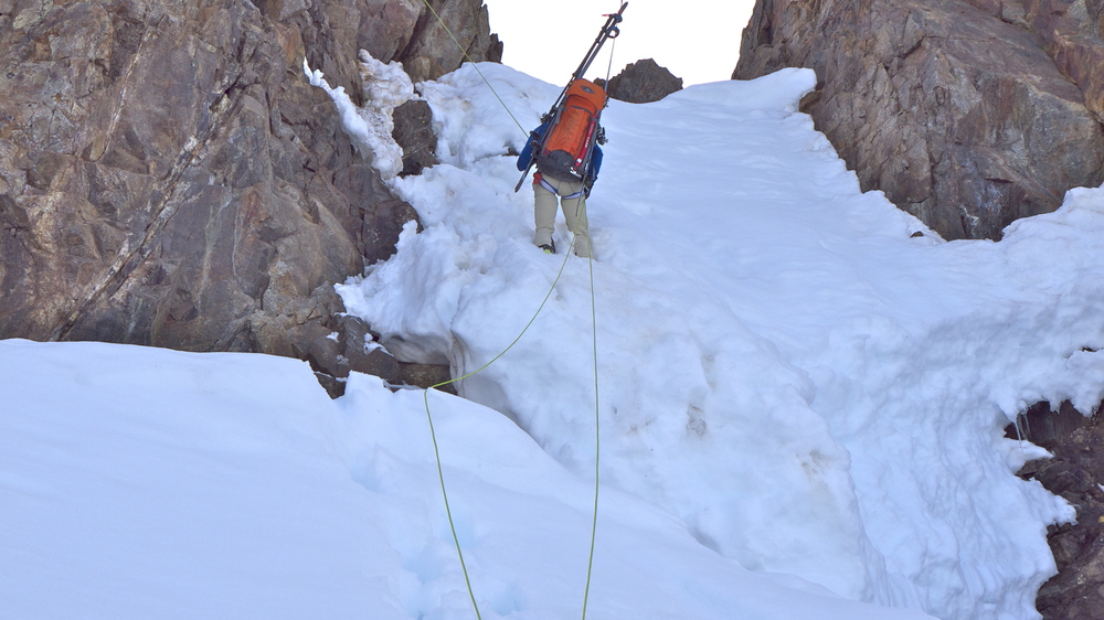 Trevor rappels onto the Boston Glacier.