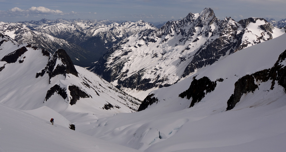 Skiing down the Douglas Glacier on the east side of Mt. Logan, Mt. Goode in the distance.