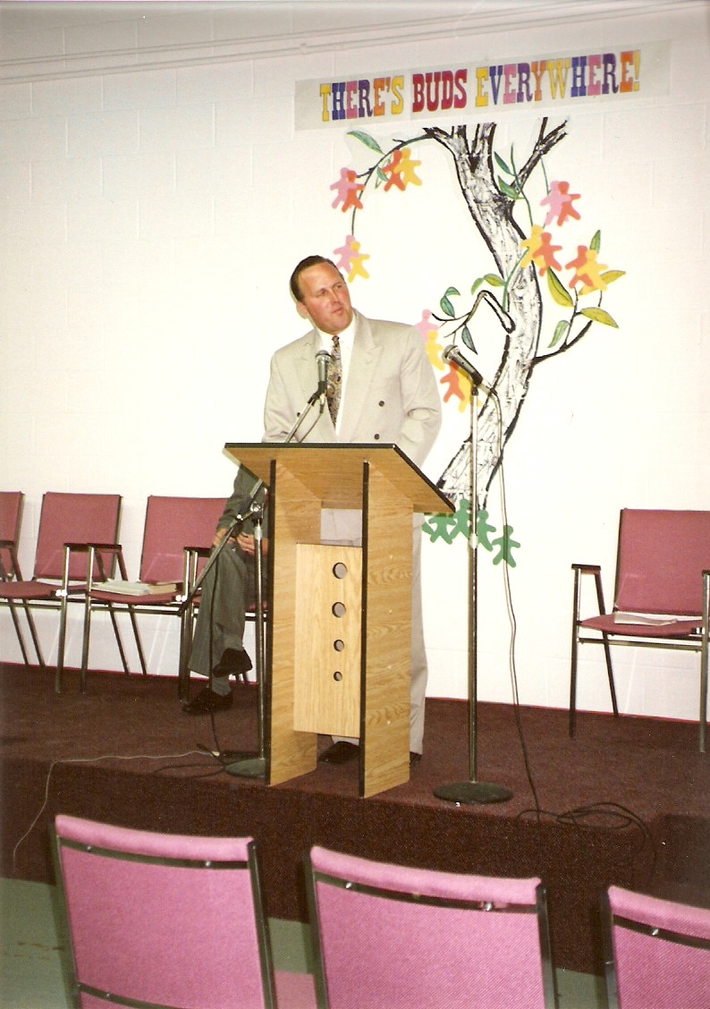 Rev. Bryson Preaching at the old location (768 Westney Rd.) - 1992