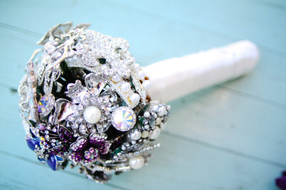 All But Flowers offers the prettiest brooch bouquets and paper pomander balls you've ever seen! Stop by their booth and create a custom look to fit your wedding palette!