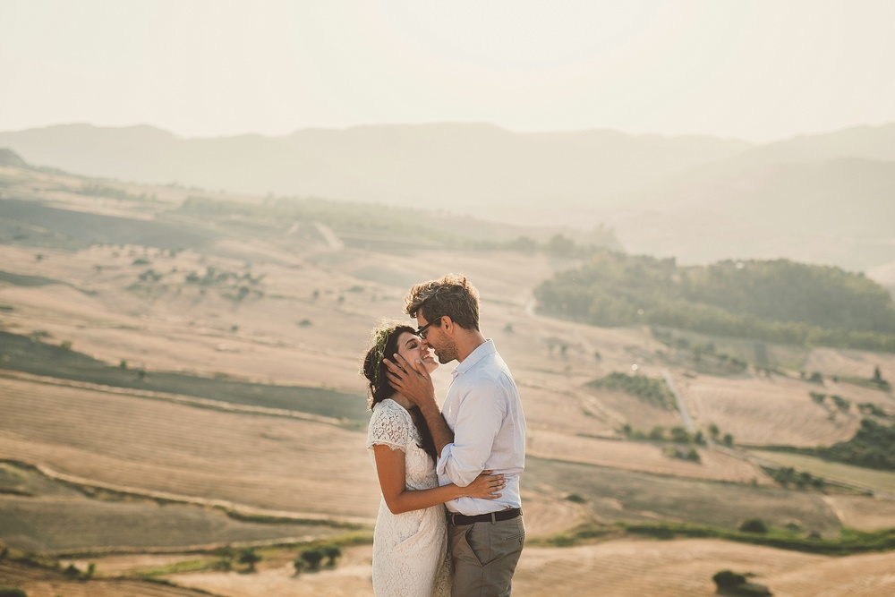 Wedding Photography Carly Romeo Photography Richmond VA Aidone Sicily Italy Couple Kiss Landscape Backdrop Beautiful Elopement