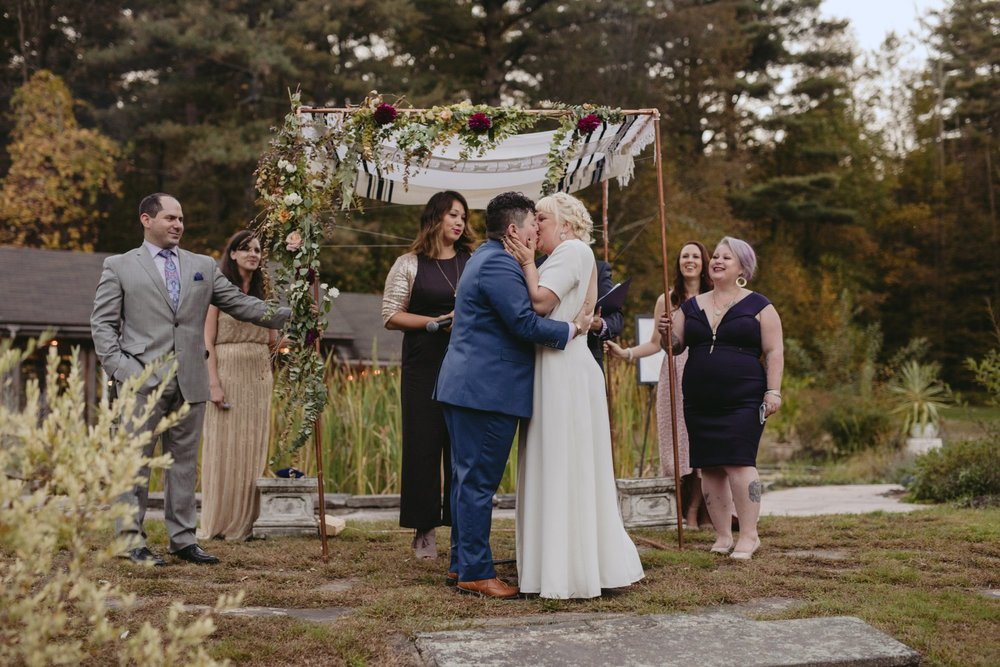 October Jewish lesbian wedding at Foxfire Mountain House in Upstate New York. First Kiss.