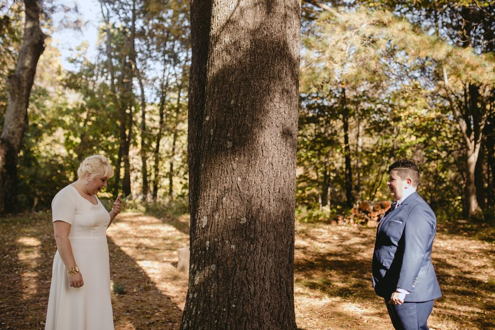 October Jewish lesbian wedding at Foxfire Mountain House in Upstate New York. First Look.