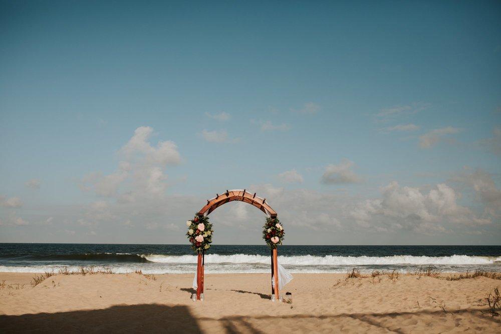 Low key backyard beach wedding in Sandbridge, VA archway ceremony