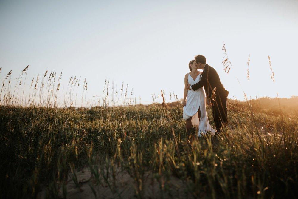 Low key backyard beach wedding in Sandbridge, VA dune sunset kiss