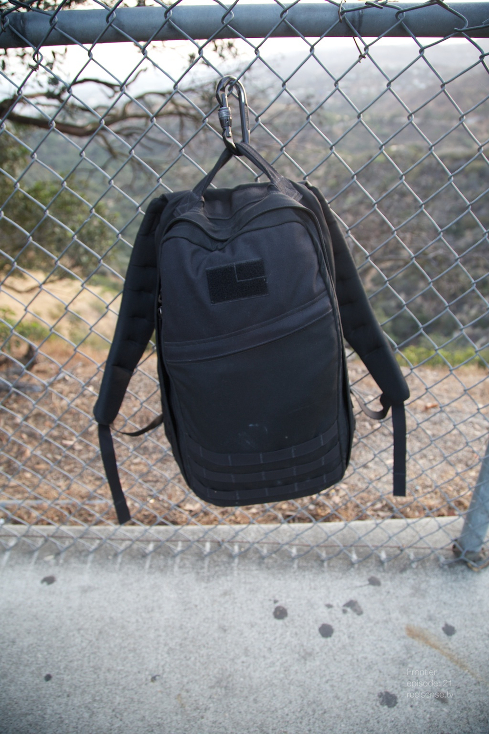 Griffith Observatory - Los Angeles - GORUCK GR1 camera bag hanging on fence via carabiner